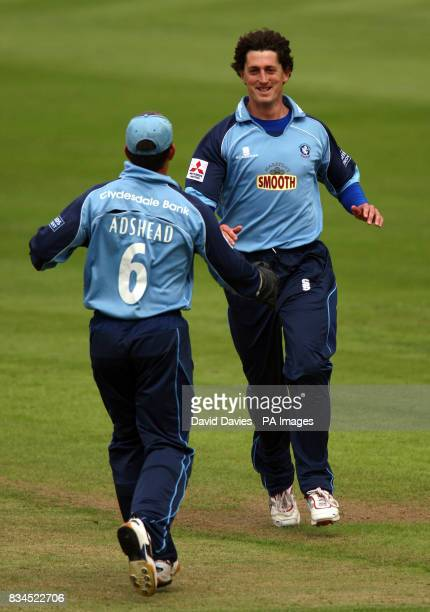 Gloucestershire's Jonathan Lewis celebrates with team mate Steve Adshead after bowling out Yorkshire's Andrew Gale