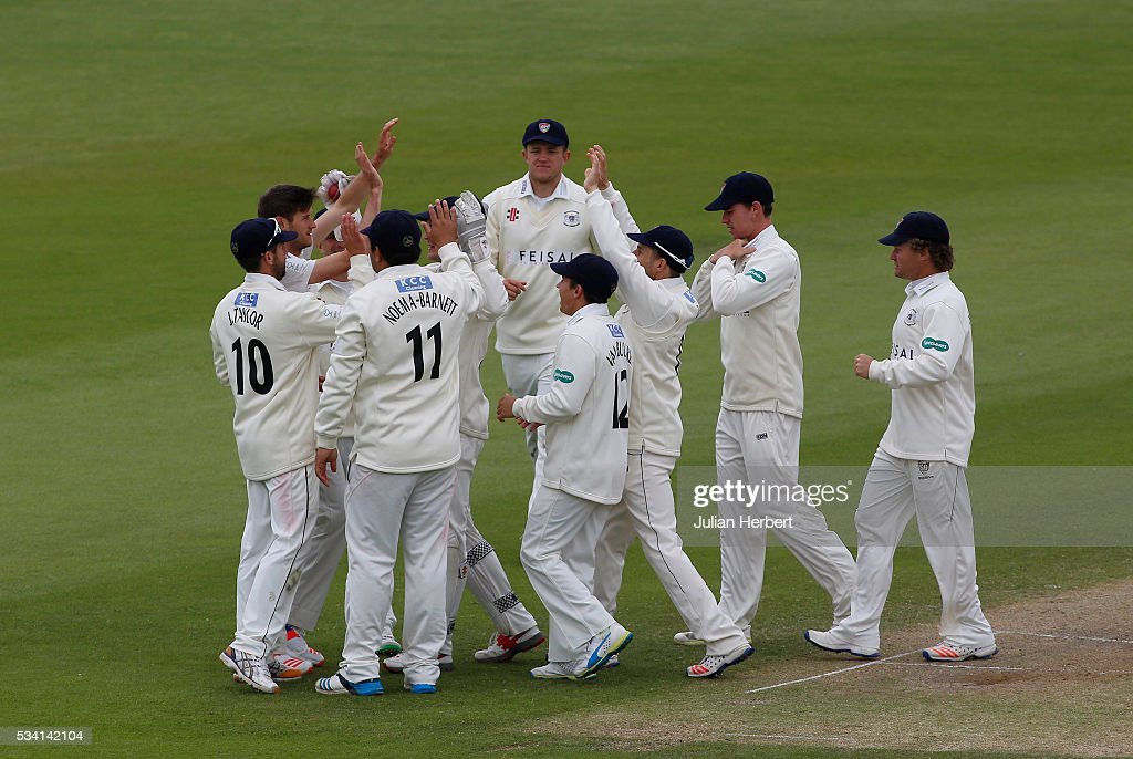 Gloustershire players celerate the wicket of Northamptonshire's Richard Levi during day four of the Specsavers Division Two match between Gloucestershire and Northamptonshire at The County Ground on May 25, 2016 in Bristol, England.