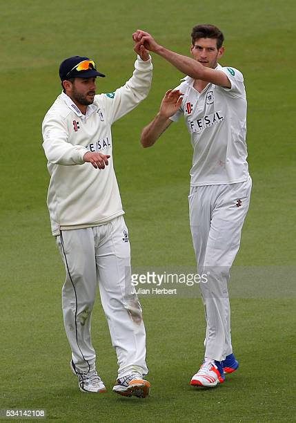 Gloustershire's David Payne and Matt Taylor celerate the wicket of Northamptonshire's Richard Levi during day four of the Specsavers Division Two...