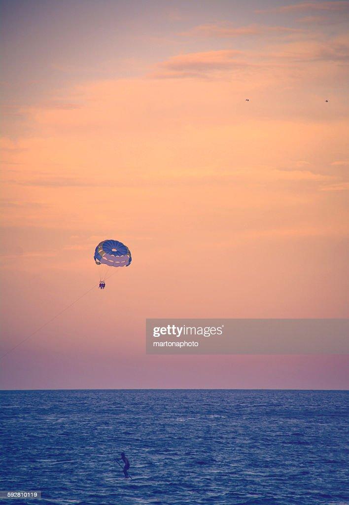 Glove above the sea on a sunset : Foto de stock