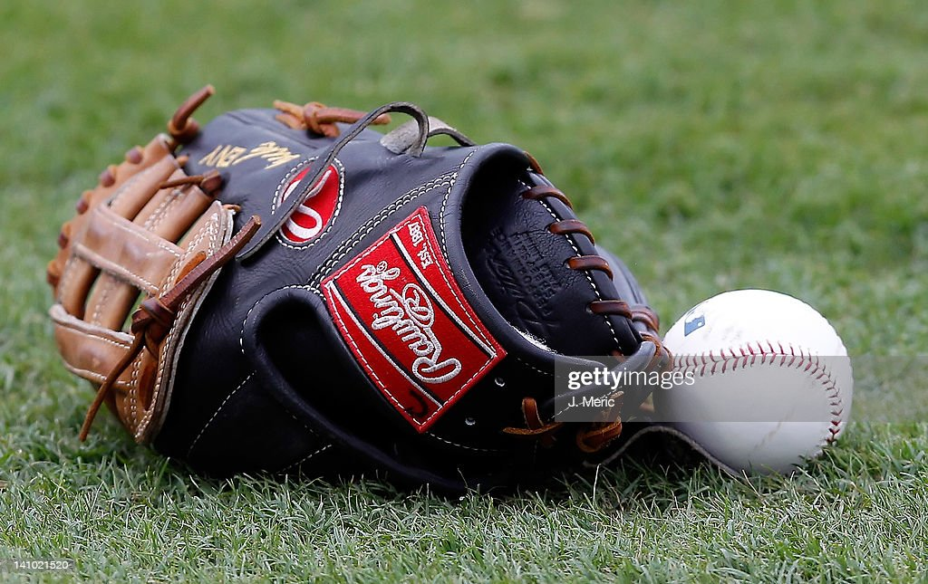 A glove and ball rest on the field just before the start of the Grapefruit League Spring Training Game between the Boston Red Sox and the Pittsburgh...