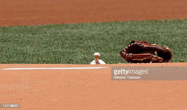 A glove and the rosin bag sit on the mound before the interleague game between the Boston Red Sox and the Atlanta Braves at Fenway Park on June 23...