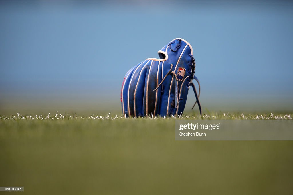 A glove belonging to Dodger shortstop Hanley Ramirez sits on the grass during warmups before the game betweenthe Los Angeles Dodgers and the Colorado Rockies on September 29, 2012 at Dodger Stadium in Los Angeles, California. The Dodgers won 3-0.