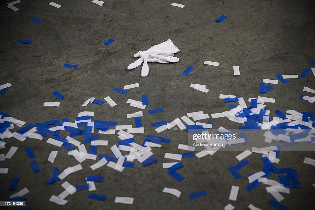 A glove is left on the floor after the New York City Police Academy cadet graduation ceremony at the Barclays Center on July 2, 2013 in the Brooklyn Borough of New York City. The New York Police Department (NYPD) has more than 37,000 officers; 781 cadets graduated today.