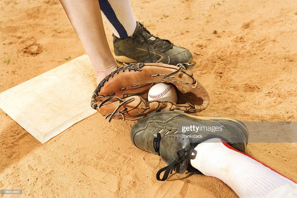 Glove of baseball player tagging runner out