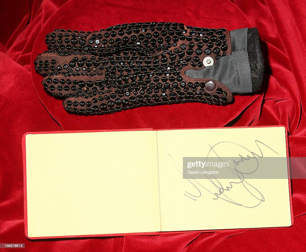 A glove worn by recording artist Michael Jackson and his autograph are displayed at Nate D. Sanders media preview for Michael Jackson's 1980's iconic stage-worn items on December 14, 2012 in Los Angeles, California.