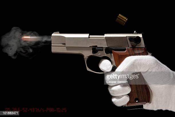 A Gloved Hand Firing A Gun