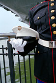 Gloved hand holding a Marine hat