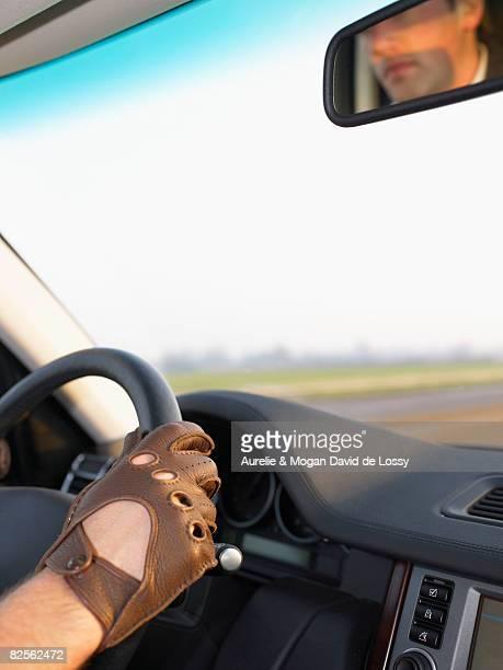 Gloved hand on steering wheel