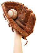 Want to play catch? Photo of a hand wearing a big baseball glove with a baseball inside of it. Isolated on white, perfect in camera isolation achieved using a blown background. Please zoom in to see t