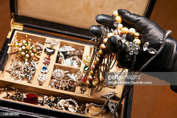 Gloved hand stealing jewelry