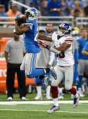 Glover Quin of the Detroit Lions intercepts a pass intended for Victor Cruz of the New York Giants during the third quarter at Ford Field on...