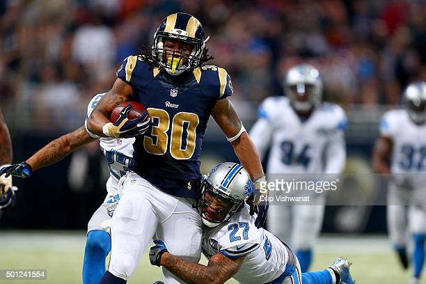 Glover Quin tries to tackle Todd Gurley of the St Louis Rams as he carries the ball in the third quarter at the Edward Jones Dome on December 13 2015...