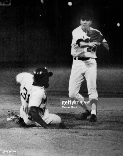 Glover Strikes in Twin Killing Jim Glover pivots and makes throw on a dazzling double play by the Denver Bears in second inning of game against...