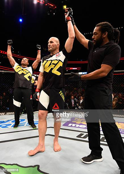 Glover Teixeira celebrates his knockout victory over Rashad Evans in their light heavyweight bout during the UFC Fight Night event at Amalie Arena on...