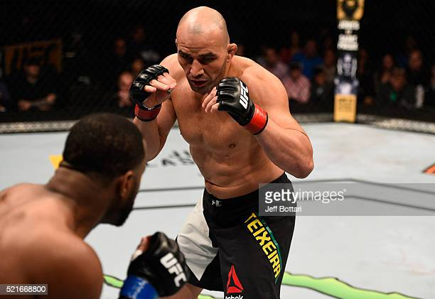 Glover Teixeira circles Rashad Evans in their light heavyweight bout during the UFC Fight Night event at Amalie Arena on April 16 2016 in Tampa...