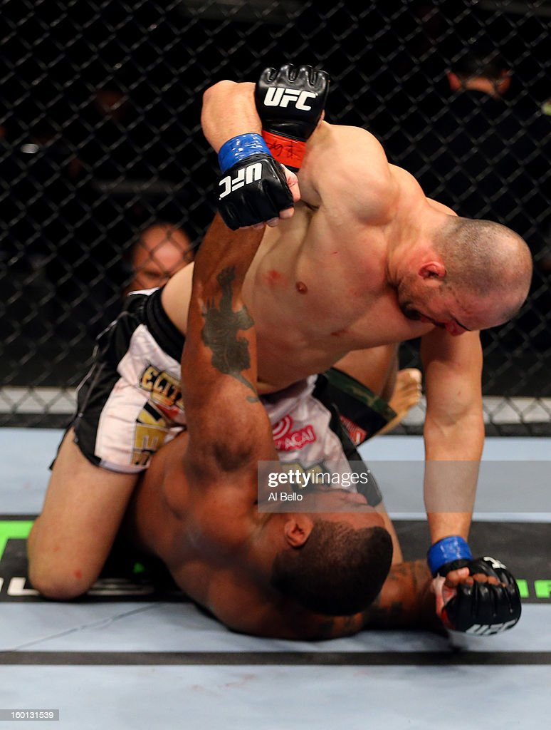 Glover Teixeira (Top) fights Rampage Jackson (Bottom) during their Light Heavyweight Bout part of UFC on FOX at United Center on January 26, 2013 in Chicago, Illinois.
