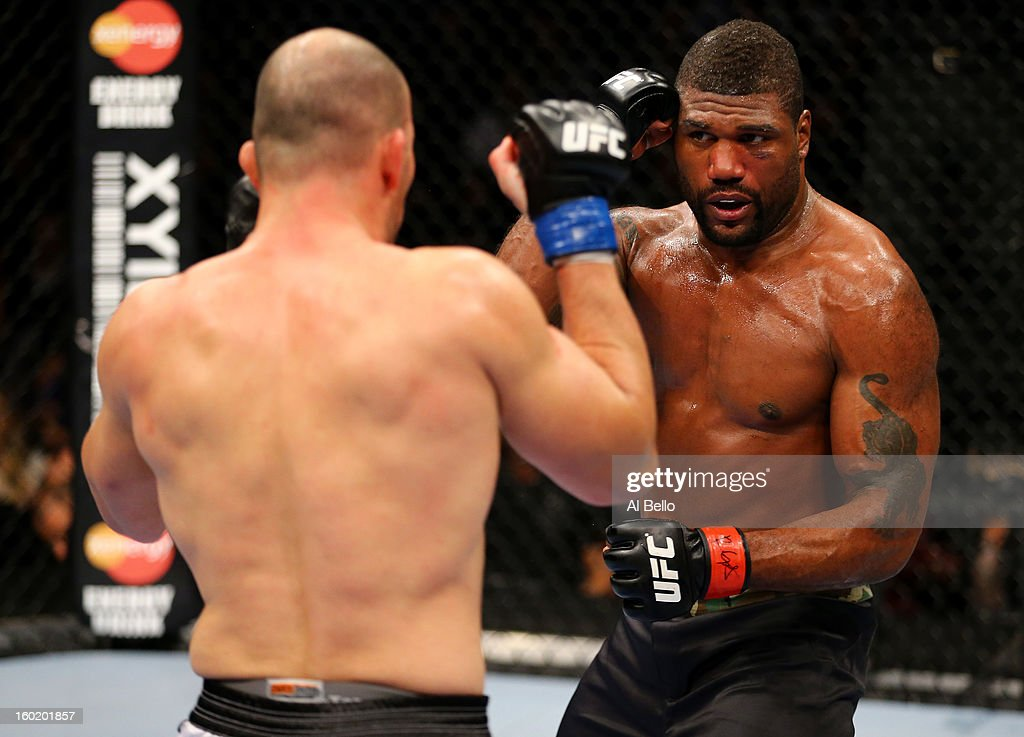 Glover Teixeira (L) fights Rampage Jackson (R) during their Light Heavyweight Bout part of UFC on FOX at United Center on January 26, 2013 in Chicago, Illinois.