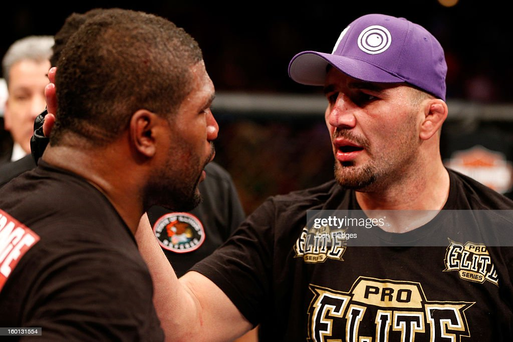 Glover Teixeira (R) hugs Rampage Jackson (L) after defeating him in their Light Heavyweight Bout part of UFC on FOX at United Center on January 26, 2013 in Chicago, Illinois.