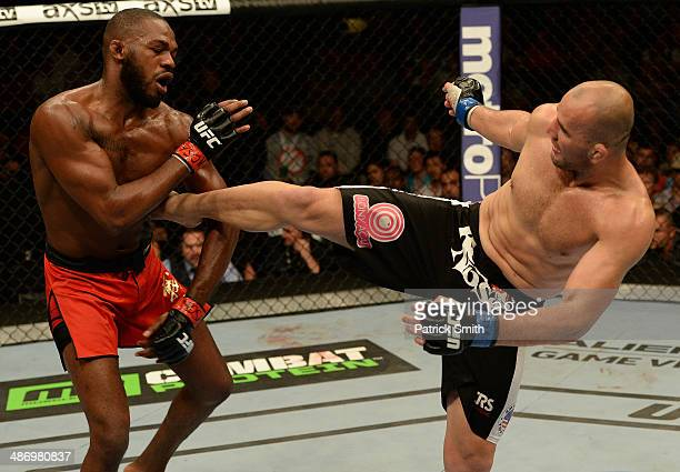 Glover Teixeira kicks Jon 'Bones' Jones in their light heavyweight championship bout during the UFC 172 event at the Baltimore Arena on April 26 2014...
