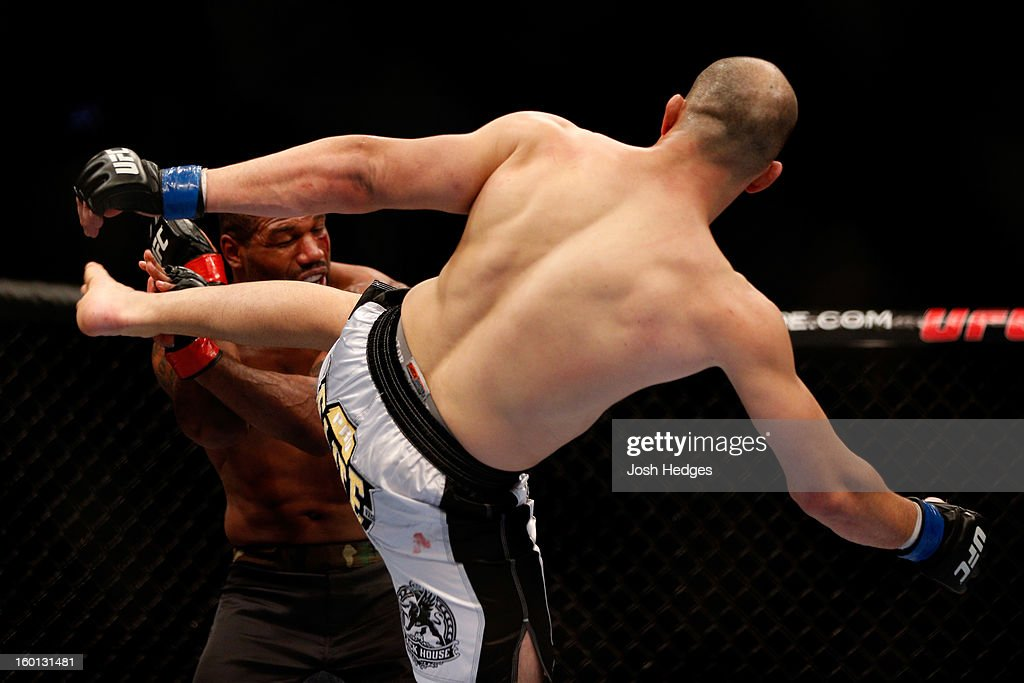 Glover Teixeira (R) kicks Rampage Jackson (L) during their Light Heavyweight Bout part of UFC on FOX at United Center on January 26, 2013 in Chicago, Illinois.