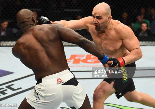 Glover Teixeira of Brazil punches Jared Cannonier in their light heavyweight bout during the UFC 208 event inside Barclays Center on February 11 2017...