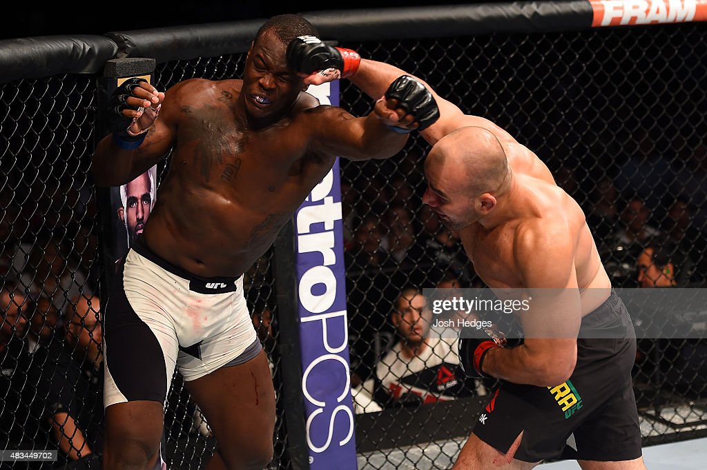 Glover Teixeira of Brazil punches Ovince Saint Preux in their light heavyweight bout during the UFC Fight Night event at Bridgestone Arena on August 8, 2015 in Nashville, Tennessee.