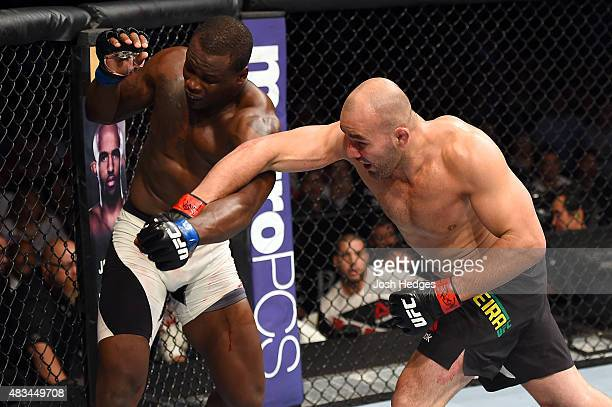 Glover Teixeira of Brazil punches Ovince Saint Preux in their light heavyweight bout during the UFC Fight Night event at Bridgestone Arena on August...