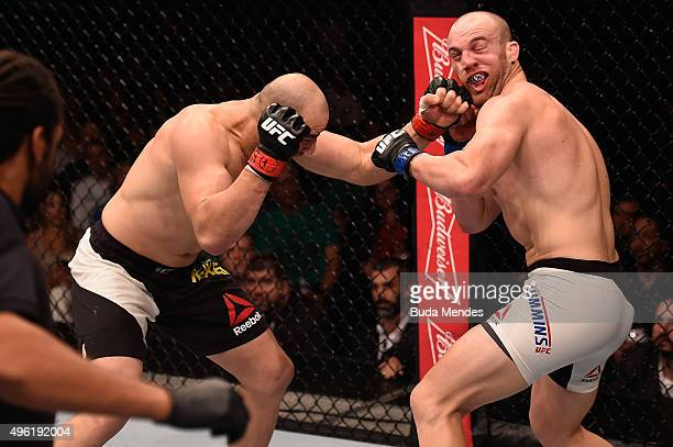 Glover Teixeira of Brazil punches Patrick Cummins of the United States in their light heavyweight bout during the UFC Fight Night Belfort v Henderson...