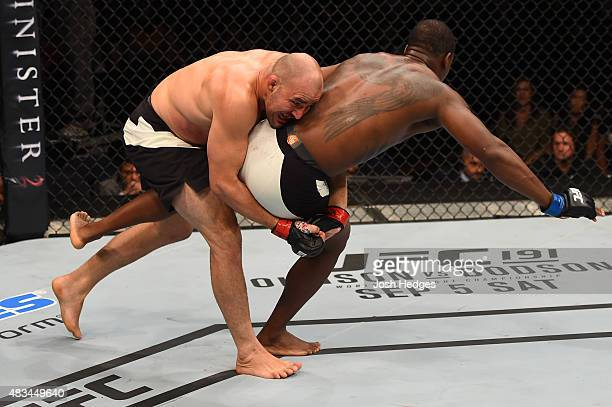 Glover Teixeira of Brazil takes down Ovince Saint Preux in their light heavyweight bout during the UFC Fight Night event at Bridgestone Arena on...