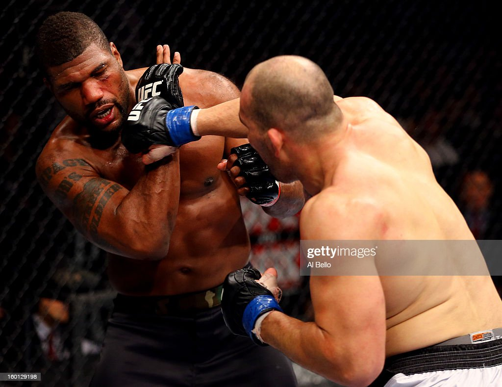 Glover Teixeira (R) punches Rampage Jackson (L) during their Light Heavyweight Bout part of UFC on FOX at United Center on January 26, 2013 in Chicago, Illinois.