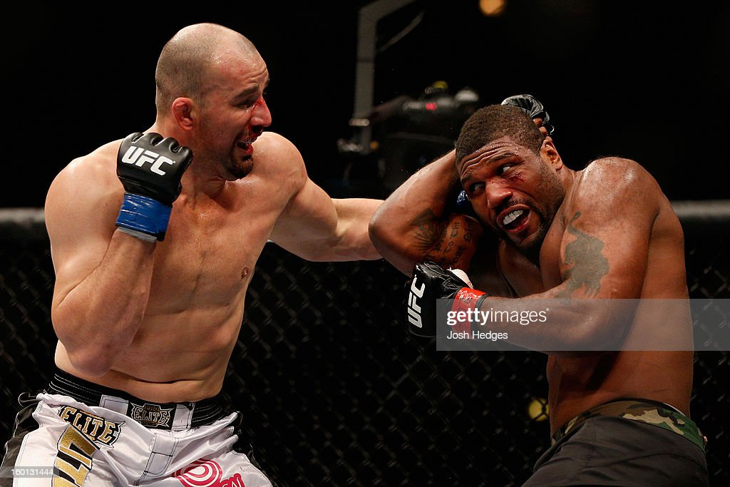Glover Teixeira (L) punches Rampage Jackson (R) during their Light Heavyweight Bout part of UFC on FOX at United Center on January 26, 2013 in Chicago, Illinois.