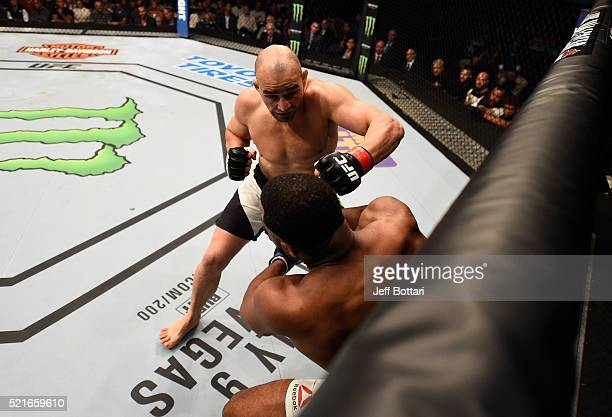 Glover Teixeira punches Rashad Evans in their light heavyweight bout during the UFC Fight Night event at Amalie Arena on April 16 2016 in Tampa...