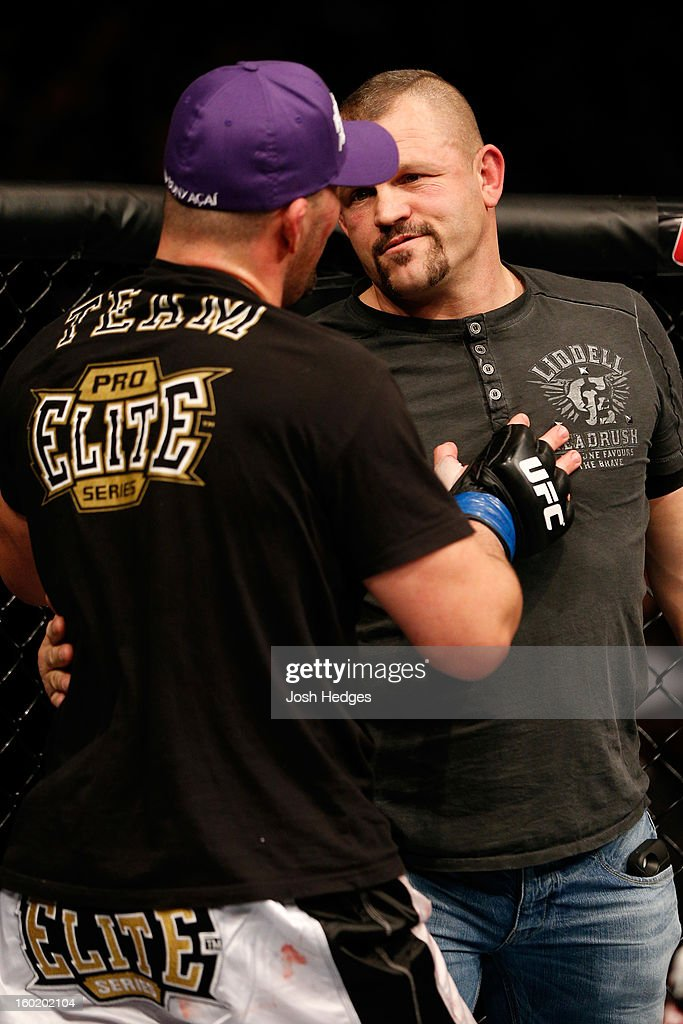 Glover Teixeira (L) talks with Former UFC champion Chuck Liddell (R) after fighting Rampage Jackson in their Light Heavyweight Bout part of UFC on FOX at United Center on January 26, 2013 in Chicago, Illinois.