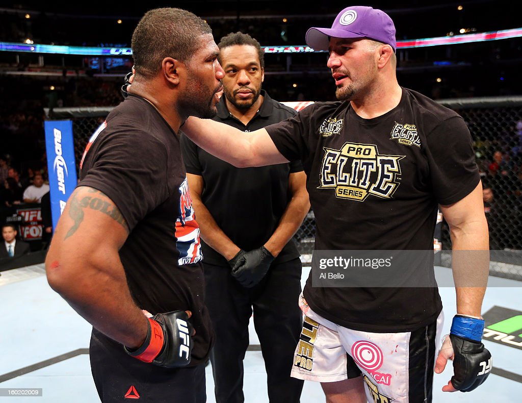 Glover Teixeira (R) talks with Rampage Jackson (L) after their Light Heavyweight Bout part of UFC on FOX at United Center on January 26, 2013 in Chicago, Illinois.