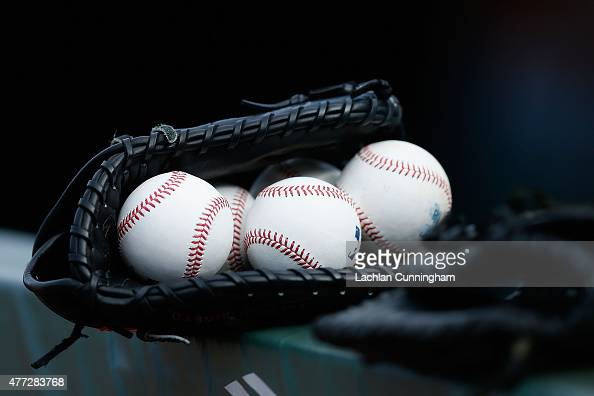Gloves and balls in the Seattle Mariners dugout during batting practice before their game against the San Francisco Giants at ATT Park on June 15...