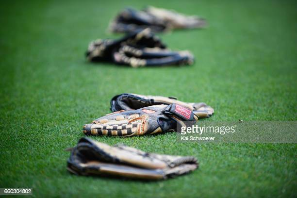 Gloves are seen lying on the pitch as mist and a wet outfield delay play during the Plunket Shield match between Canterbury and Wellington on March...