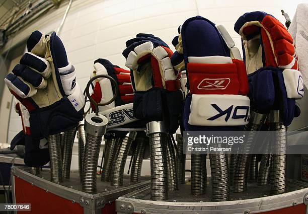 Gloves sit on a glove dryer outside of the locker room before the NHL game between the Pittsburgh Penguins and the New York Rangers at Mellon Arena...