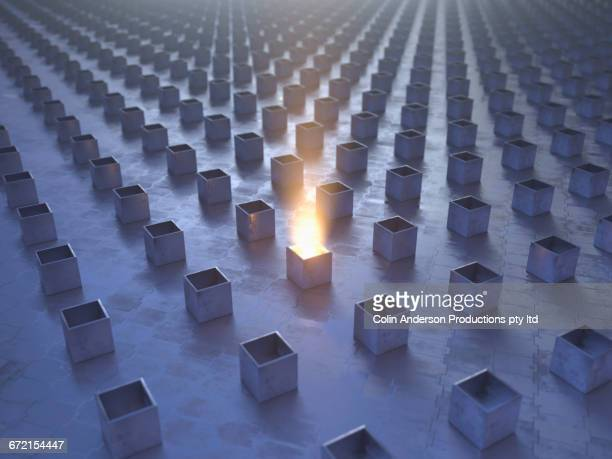 Glowing box in rows of boxes