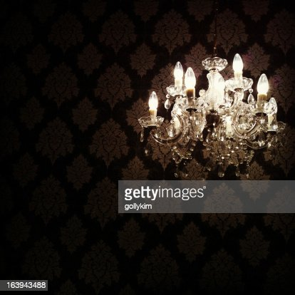 Glowing Chandelier Hanging in Darkness