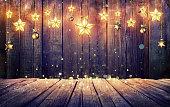 Vintage Lights Stars Hanging At Wooden Background