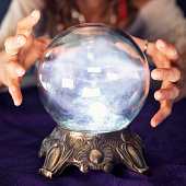 Young woman Gypsy using a crystal ball.