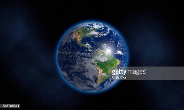 Glowing Earth floating in space