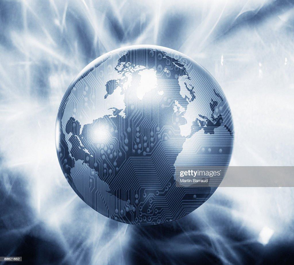 Glowing globe with microchip overlay : Stock Photo