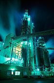 Glowing Industrial Plant at Night