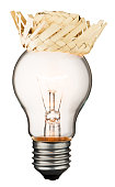 Glowing light bulb with a straw hat isolated on white background with a clipping path