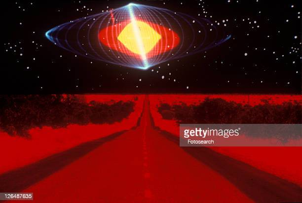 A glowing pattern of laser lights against a black background above a glowing red highway extending to the horizon