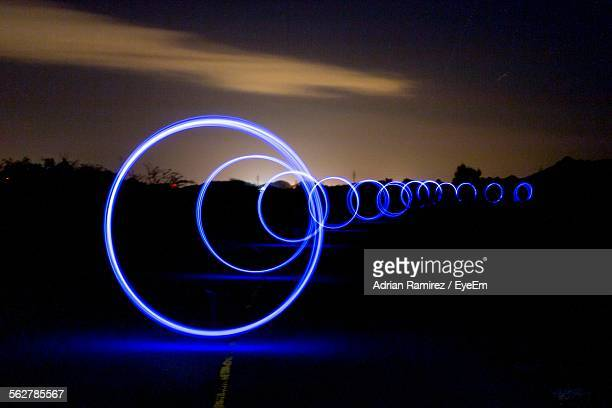 Glowing Rings In Row At Night