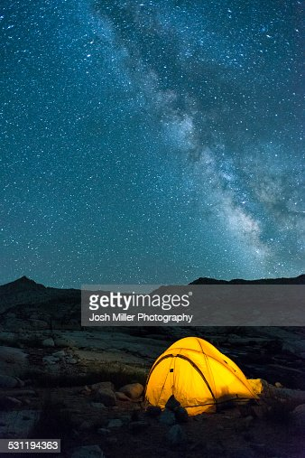 Glowing tent and stars in High Sierra