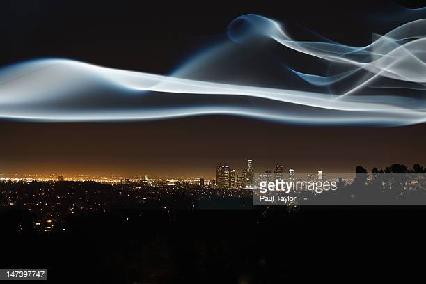 Glowing Vapor Hovering over Cityscape